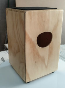 Back of a cajon with sound hole.