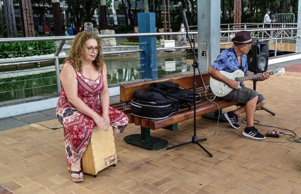 A tourist tries out playing cajon.