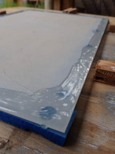 Apply a layer of epoxy to the edges of the polycarbonate.