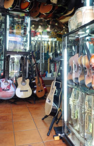 Guitars, violins trumpets in a small music store in Lima Peru