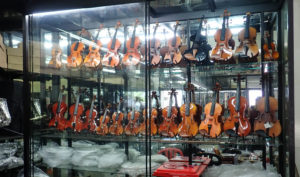 Violins in a glass case for sale