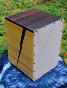 Cajon with a polycarbonate back attached with only screws.