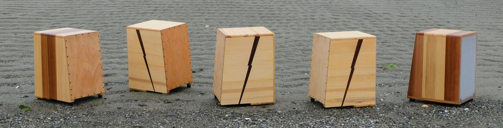 Five cajons with resonant heads on a beach