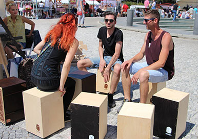 Folks playing Pisch Percussion on a sunny day in Slovankia
