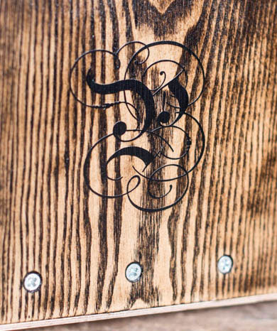 In Greece, Prodromos Cajons uses an artistic script on the front of their cajons. Photo copyright Prodomos Cajon Instruments.