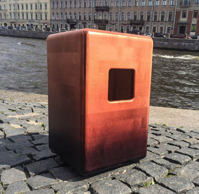 The Saint Petersburg Cajon Club's square sound hole is unique. Here the cajon sits along a river walkway.