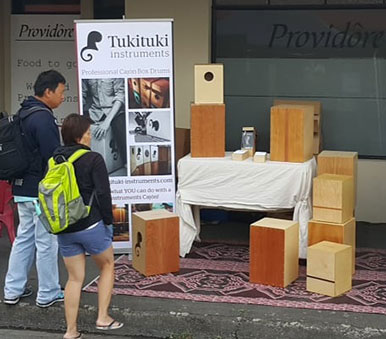 Tukituki Instruments display with cajons for sale at a local market in New Zealand